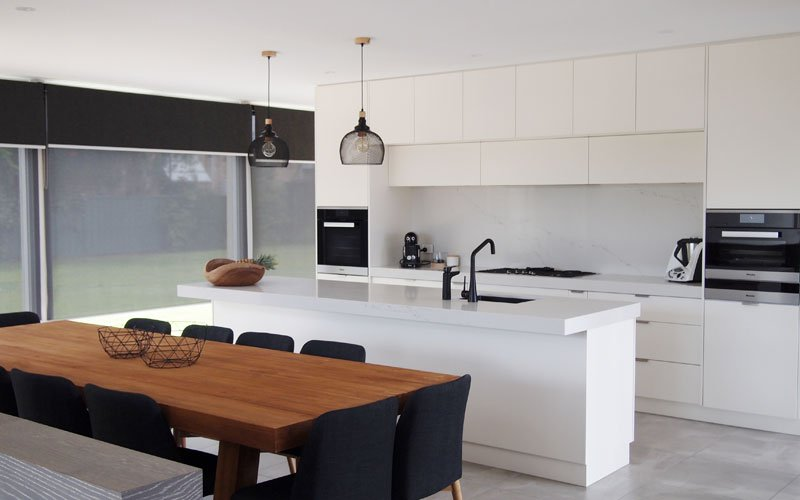 white kitchen with black tapware