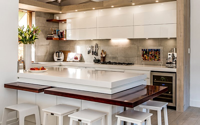 kitchen with stone tile splashback