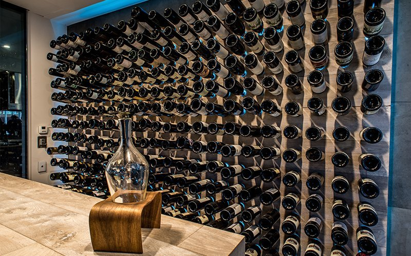 wine in a rack on the wall