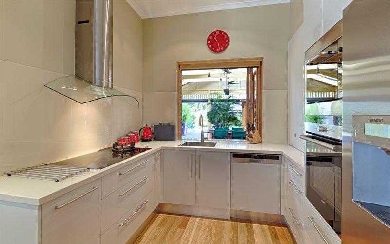 Kitchen renovation with glass rangehood