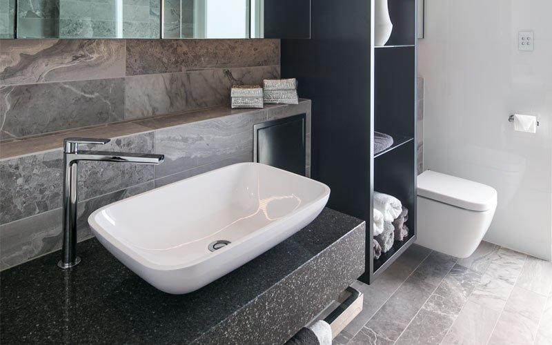 bathroom with towel storage